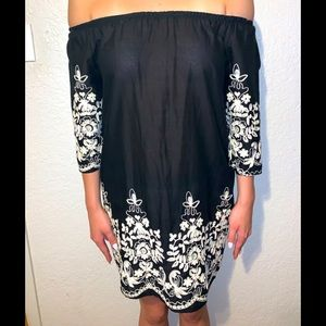 Black dress with white embroidery